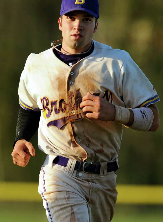 CBA's Matt Sand (7) runs sprints at the end of their baseball game against Troy on Friday, April 20, 2012, at Christian Brothers Academy in Colonie, N.Y. (Cindy Schultz / Times Union) Photo: Cindy Schultz / 00017290A