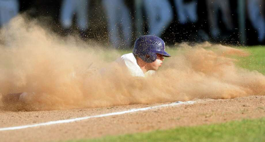 CBA's Matt Sand (7) produces a cloud of dust as he safely slides into third base during their baseball game against Troy on Friday, April 20, 2012, at Christian Brothers Academy in Colonie, N.Y. (Cindy Schultz / Times Union) Photo: Cindy Schultz / 00017290A