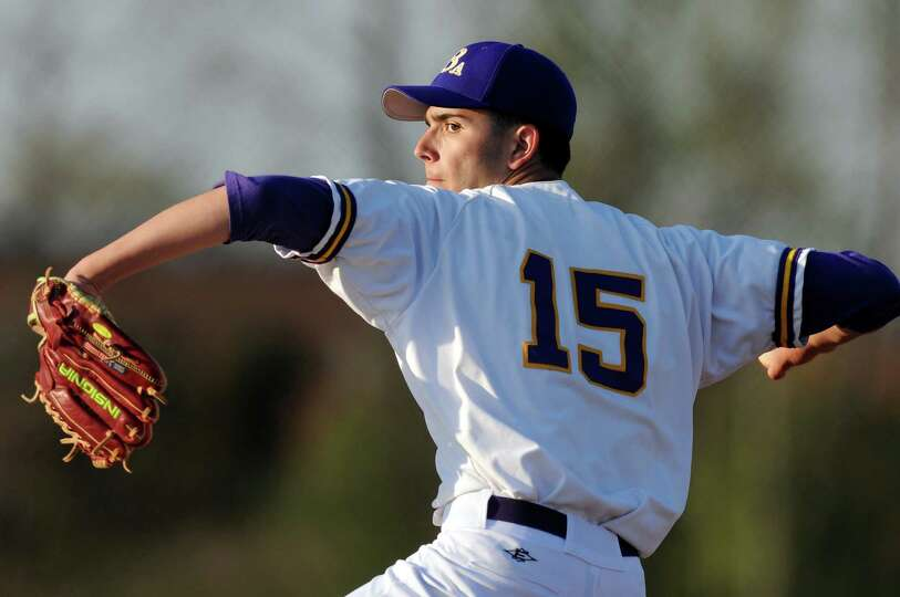 CBA's Jackson Raimo (15) winds up a pitch during their baseball game against Troy on Friday, April 2