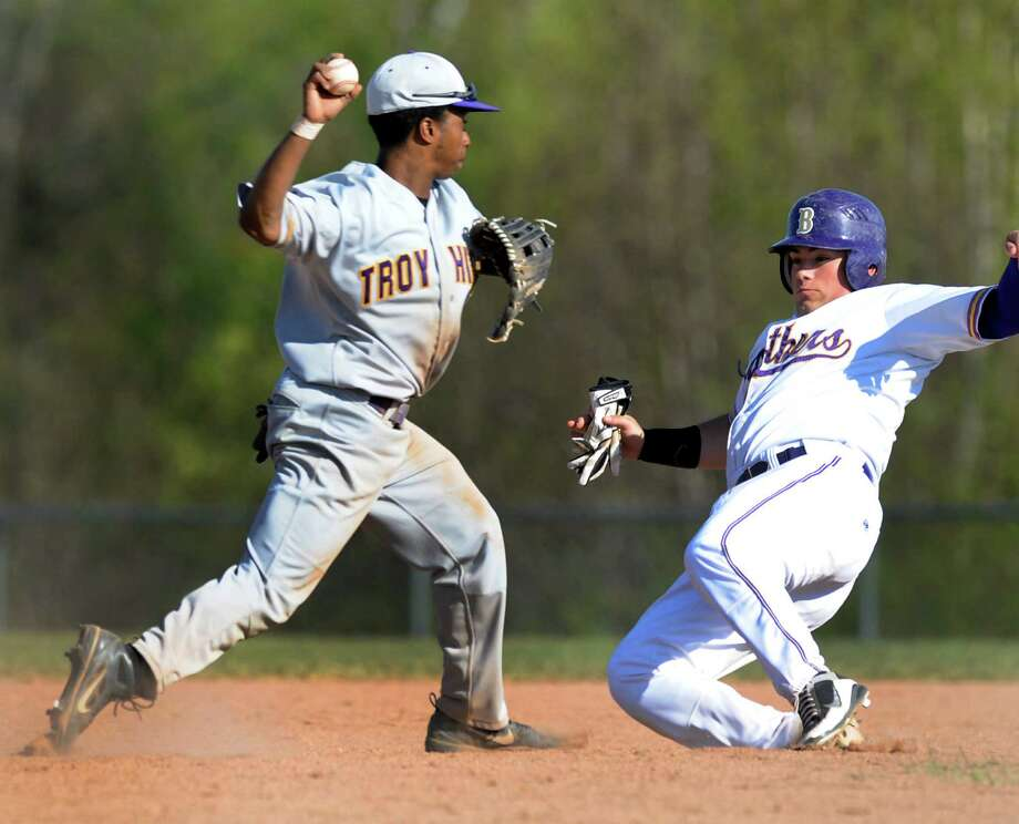 Troy's Zeb Gaston (8), left, forces out CBA's Zach DeThomasis (3) at second and turns the double play during their baseball game on Friday, April 20, 2012, at Christian Brothers Academy in Colonie, N.Y. (Cindy Schultz / Times Union) Photo: Cindy Schultz / 00017290A
