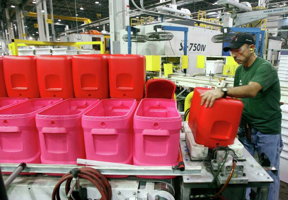 Juan Hernandez does his part on a production line at Igloo's 1.3-million-square-foot manufacturing and warehouse operation in Katy. It employs about 700 full-time workers. Photo: James Nielsen / © 2011 Houston Chronicle