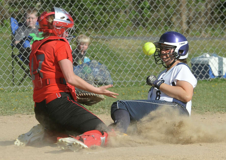 Columbia's Natasha Schultz is safe at home base covered by Niskayuna's catcher Ally Coyne during a softball game on April 20, 2012 in East Greenbush, N.Y. (Lori Van Buren / Times Union) Photo: Lori Van Buren