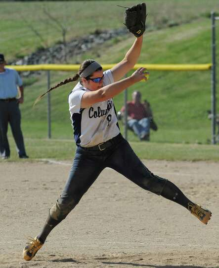 Columbia pitcher Caitlin Cooper winds up during a softball game against Niskayuna on April 20, 2012