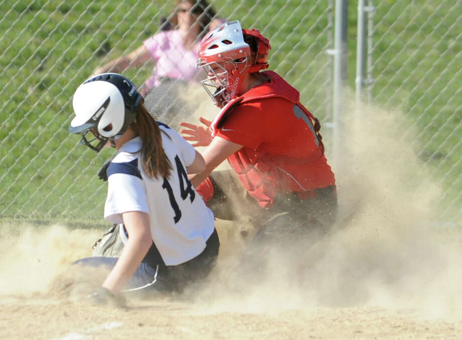 Columbia's Liz Dickie is safe at home base covered by Niskayuna's catcher Ally Coyne during a softball game on April 20, 2012 in East Greenbush, N.Y. (Lori Van Buren / Times Union) Photo: Lori Van Buren