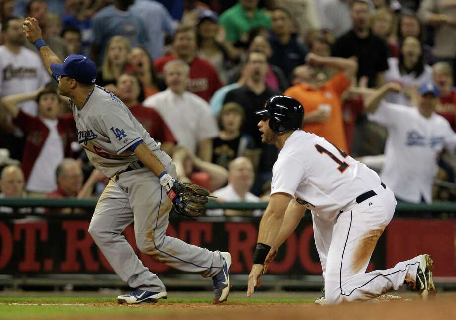 Dodgers' Jerry Hairston Jr. forces Astros' J. D. Martinez out at third base in a close play during the fifth inning Friday. Photo: Melissa Phillip / © 2012 Houston Chronicle