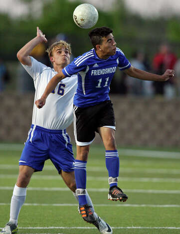 Alamo Heights' Robert Weigel (left) and Friendswood's Ryan Alvarez go after the ball during first half action of their Class 4A state semifinal game held Friday April 20, 2012 at Birkelbach Field in Georgetown, Tx. Photo: EDWARD A. ORNELAS, Express-News / © SAN ANTONIO EXPRESS-NEWS (NFS)