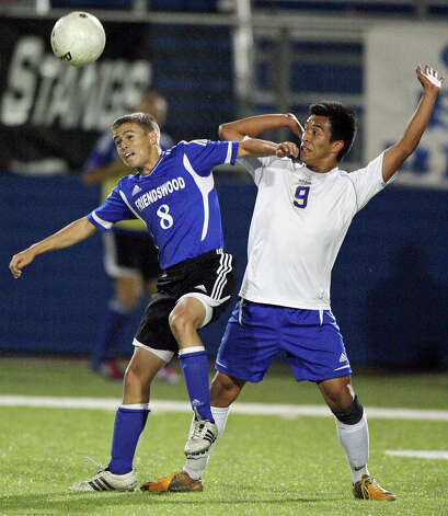 Friendswood's Micah Baize (left) and Alamo Heights' Christian Garcia  battle for control of the ball during second half action of their Class 4A state semifinal game held Friday April 20, 2012 at Birkelbach Field in Georgetown, Tx. Alamo Heights won 1-0. Photo: EDWARD A. ORNELAS, Express-News / © SAN ANTONIO EXPRESS-NEWS (NFS)