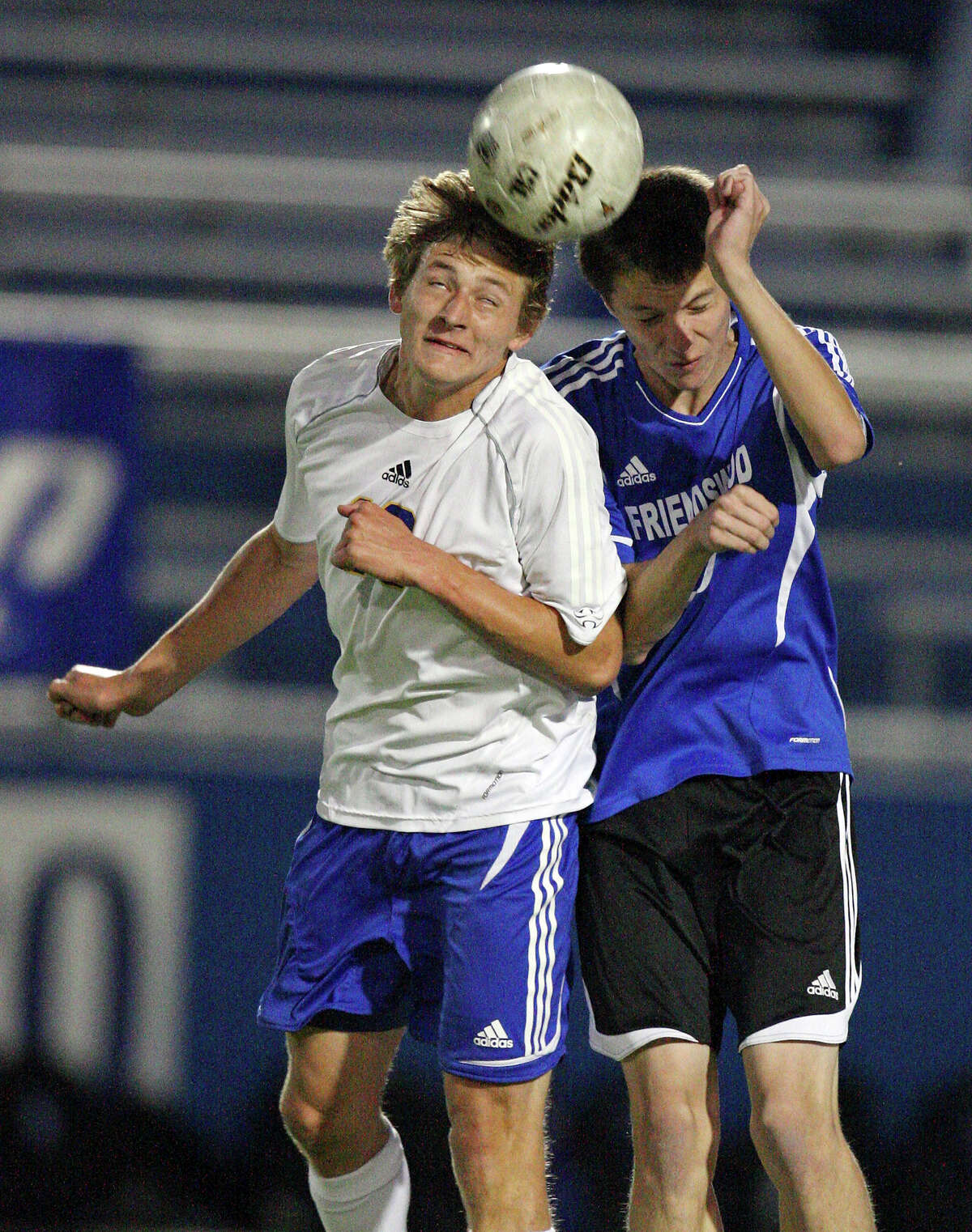 Alamo Heights' Matthew Struble (left) and Friendswood's Matthew Johnson go up for a header during first half action of their Class 4A state semifinal game held Friday April 20, 2012 at Birkelbach Field in Georgetown, Tx.