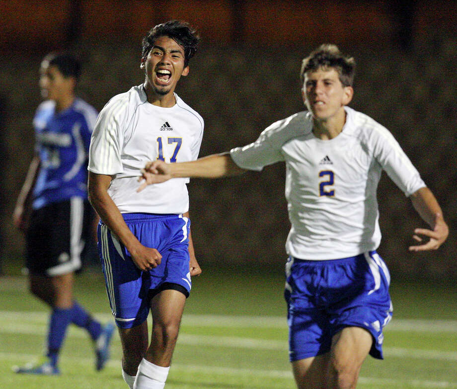 Alamo Heights' Diego Hernandez (left) and teammate Joey Ortega celebrate their 1-0 win over Friendswood in the Class 4A state semifinal game held Friday April 20, 2012 at Birkelbach Field in Georgetown, Tx. Photo: EDWARD A. ORNELAS, Express-News / © SAN ANTONIO EXPRESS-NEWS (NFS)