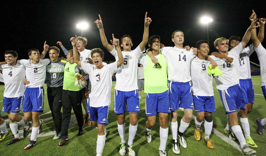 Members of the Alamo Heights Mules soccer team celebrate their 1-0 win over Friendswood in the Class 4A state semifinal game held Friday April 20, 2012 at Birkelbach Field in Georgetown, Tx.