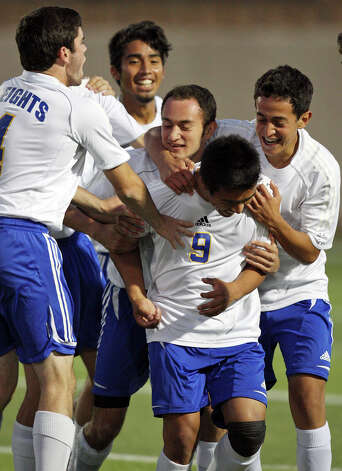 Alamo Heights' Christian Garcia (bottom center) celebrates with teammates after scoring a goal against Friendswood during first half action of their Class 4A state semifinal game held Friday April 20, 2012 at Birkelbach Field in Georgetown, Tx. Photo: EDWARD A. ORNELAS, Express-News / © SAN ANTONIO EXPRESS-NEWS (NFS)