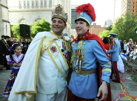 Rey Feo LXIV Richard Ojeda, left, and King Antonio XC Tom Green converse after Ojeda's coronation ceremony in Main Plaza on Friday, April 20, 2012. Billy Calzada / Express-News Photo: BILLY CALZADA, SAN ANTONIO EXPRESS-NEWS / San Antonio Express-News