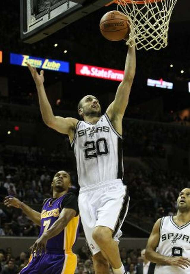 Spurs' Manu Ginobili (20) gets a layup against Los Angeles Lakers' Ramon Sessions (07) in the first half at the AT&T Center on Friday, Apr. 20, 2012. Kin Man Hui/Express-News. (San Antonio Express-News)