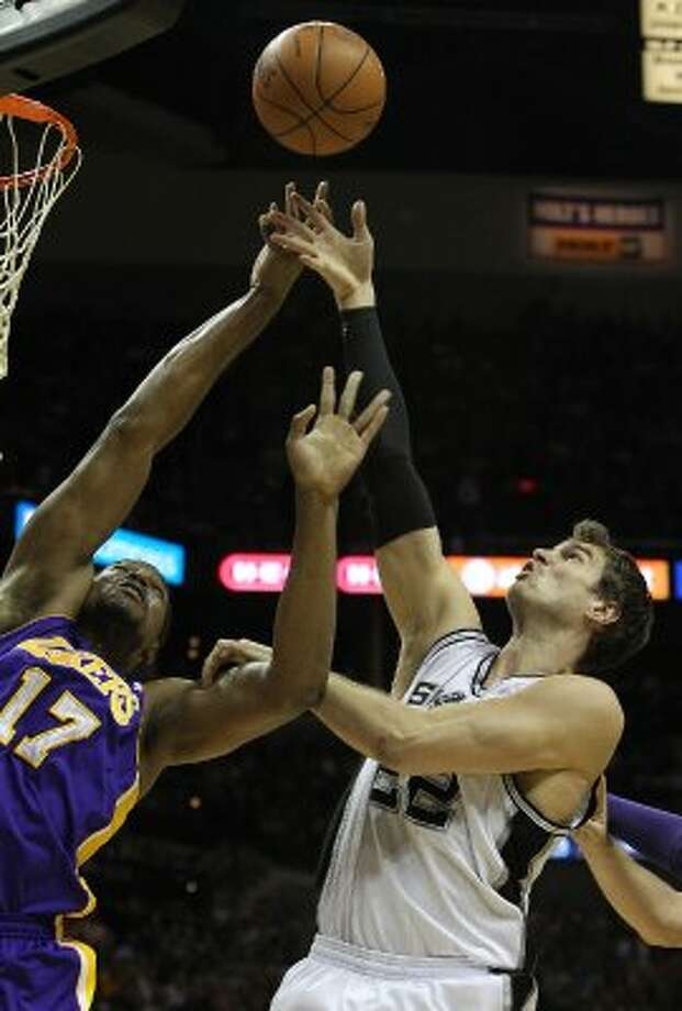 Spurs' Tiago Splitter (22) fights for a rebound against Los Angeles Lakers' Andrew Bynum (17) in the first half at the AT&T Center on Friday, Apr. 20, 2012. Kin Man Hui/Express-News. (San Antonio Express-News)