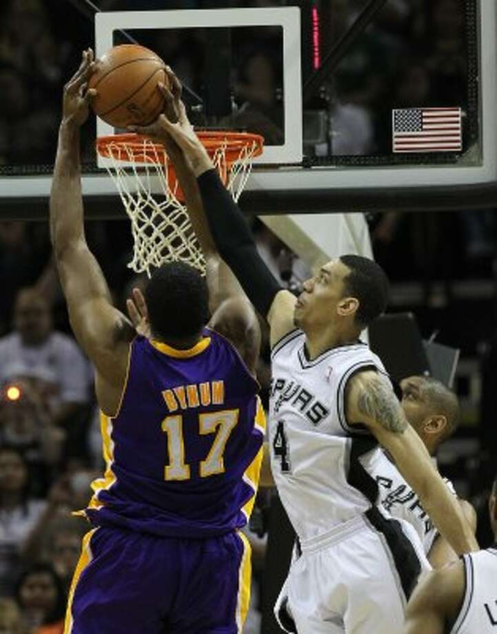 Spurs' Danny Green (04) fouls Los Angeles Lakers' Andrew Bynum (17) in the first half at the AT&T Center on Friday, Apr. 20, 2012. Kin Man Hui/Express-News. (San Antonio Express-News)