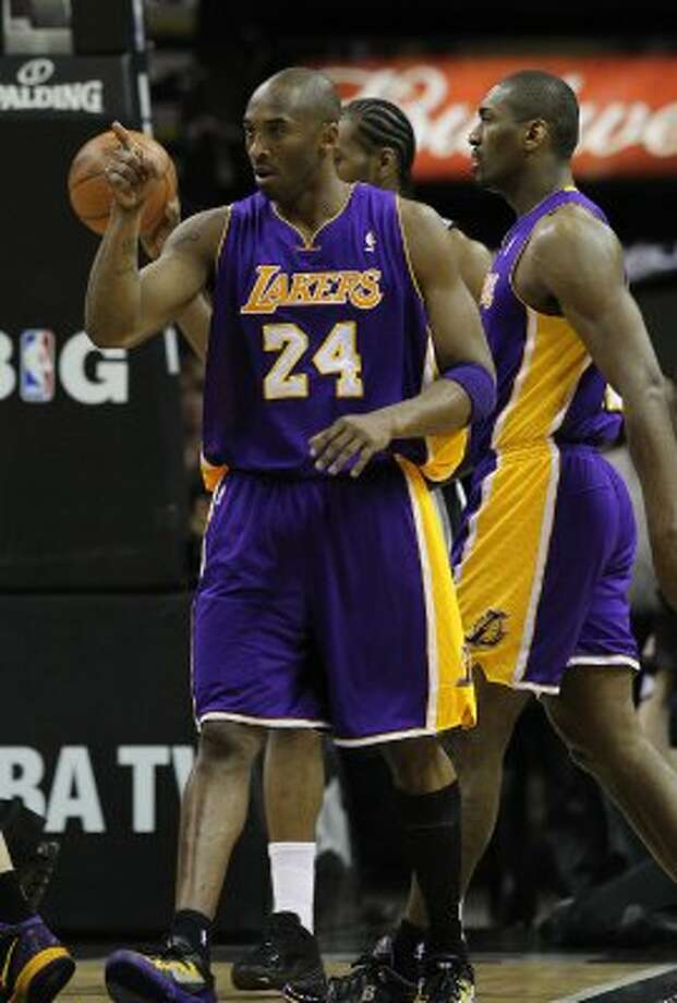 Los Angeles Lakers' Kobe Bryant (24) gestures after getting fouled in the first half against the Spurs at the AT&T Center on Friday, Apr. 20, 2012. Kin Man Hui/Express-News. (San Antonio Express-News)