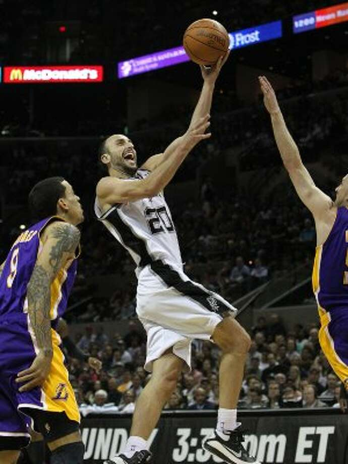 Spurs' Manu Ginobili (20) gets a shot off against Los Angeles Lakers's Matt Barnes (09) and Steve Blake (05) in the second half at the AT&T Center on Friday, Apr. 20, 2012. Spurs defeated the Lakers, 121-97. Kin Man Hui/Express-News. (San Antonio Express-News)