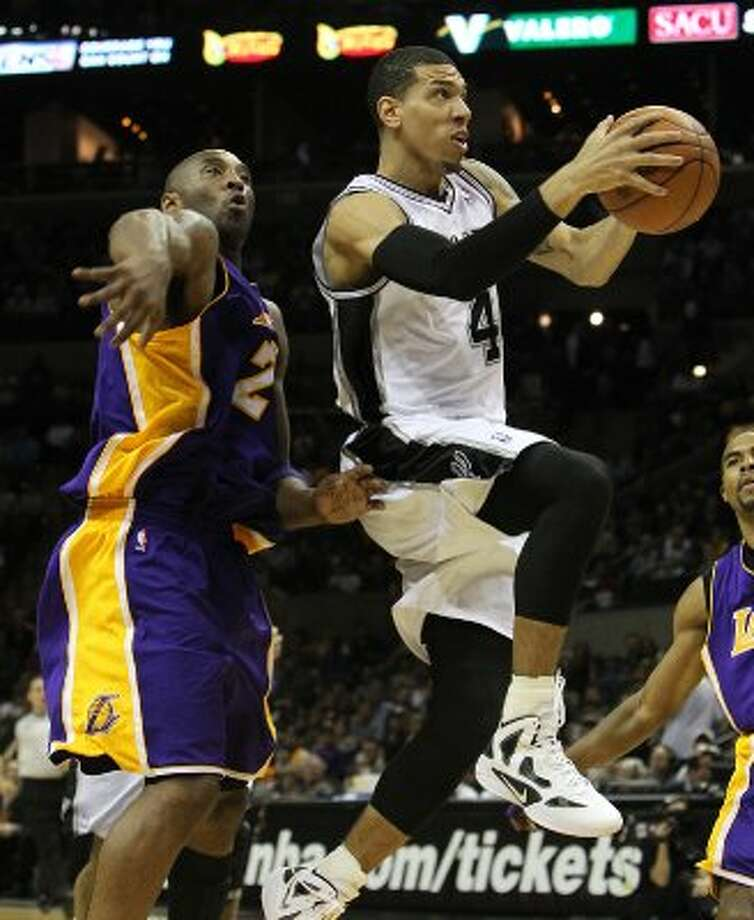 Spurs' Danny Green (04) drives past Los Angeles Lakers' Kobe Bryant (24) in the second half at the AT&T Center on Friday, Apr. 20, 2012. Spurs defeated the Lakers, 121-97. Kin Man Hui/Express-News. (San Antonio Express-News)