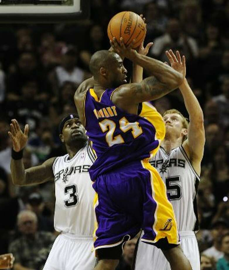 Spurs' Stephen Jackson (left) and Matt Bonner (right) apply pressure against Los Angeles Lakers' Kobe Bryant (24) in the second half at the AT&T Center on Friday, Apr. 20, 2012. Spurs defeated the Lakers, 121-97. Kin Man Hui/Express-News. (San Antonio Express-News)