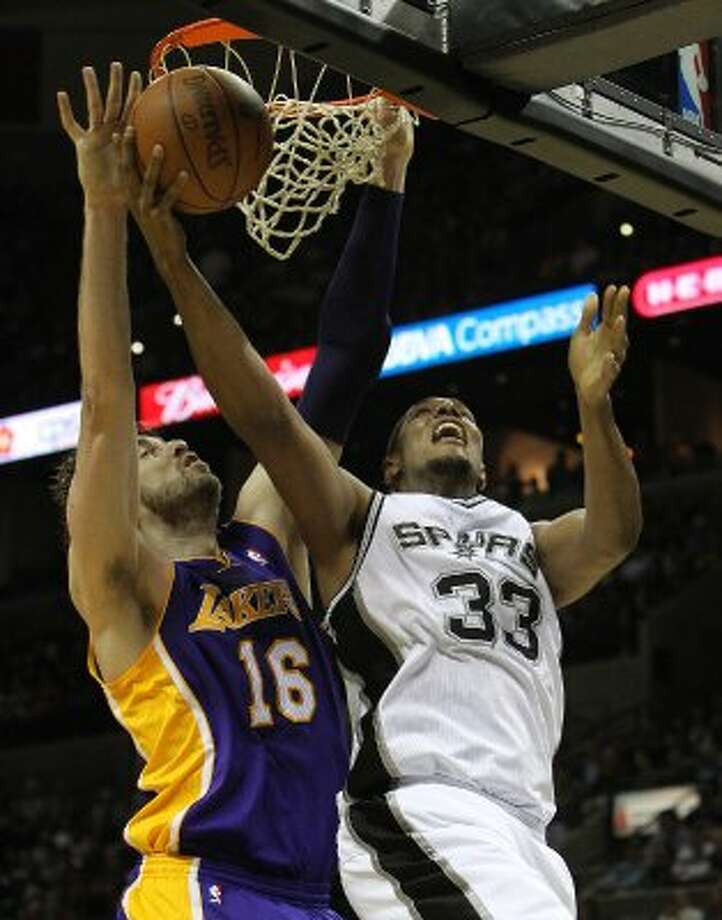 Spurs' Boris Diaw (33) goes up for a shot under the basket against Los Angeles Lakers' Pau Gasol (16) in the second half at the AT&T Center on Friday, Apr. 20, 2012. Spurs defeated the Lakers, 121-97. Kin Man Hui/Express-News. (San Antonio Express-News)