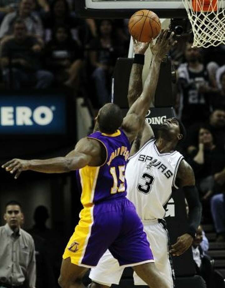 Spurs' Stephen Jackson (03) defends against Los Angeles Lakers' Metta World Peace (15) in the second half at the AT&T Center on Friday, Apr. 20, 2012. Spurs defeated the Lakers, 121-97. Kin Man Hui/Express-News. (San Antonio Express-News)