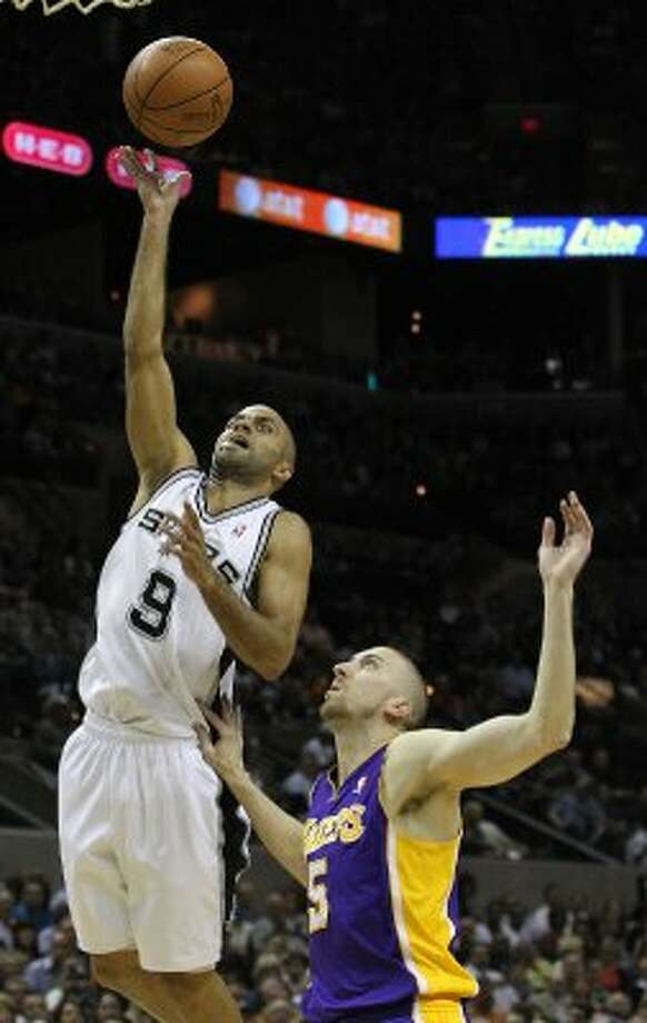 Spurs' Tony Parker (09) scores against Los Angeles Lakers' Steve Blake (05) in the first half at the AT&T Center on Friday, Apr. 20, 2012. Kin Man Hui/Express-News. (San Antonio Express-News)