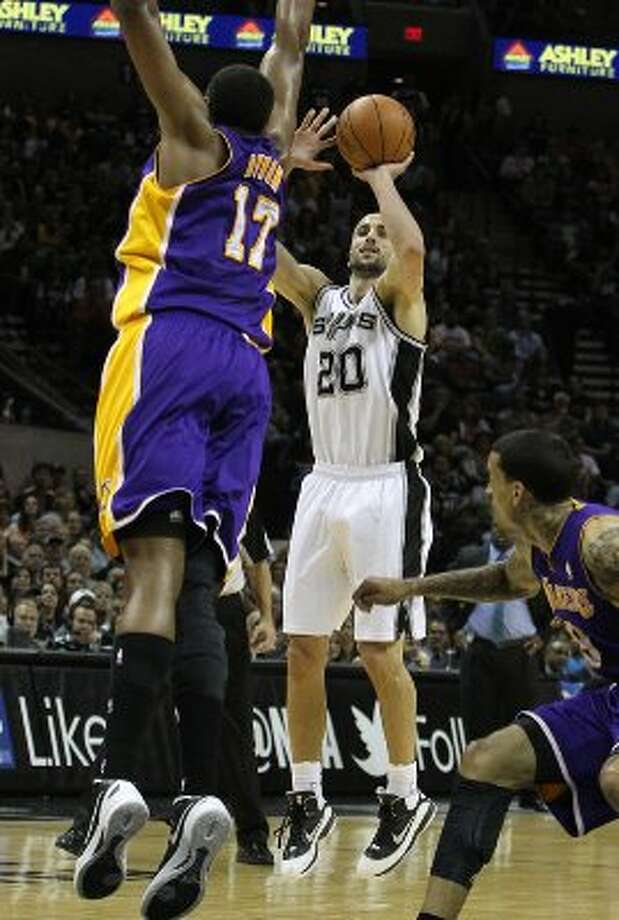 Spurs' Manu Ginobili (20) shoots over Los Angeles Lakers' Andrew Bynum (17) in the first half at the AT&T Center on Friday, Apr. 20, 2012. Kin Man Hui/Express-News. (San Antonio Express-News)