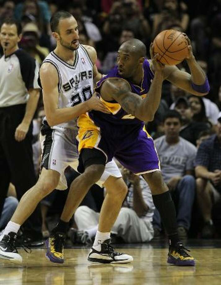 Spurs' Manu Ginobili (20) tightly guards  against Los Angeles Lakers' Kobe Bryant (24) in the first half at the AT&T Center on Friday, Apr. 20, 2012. Kin Man Hui/Express-News. (San Antonio Express-News)