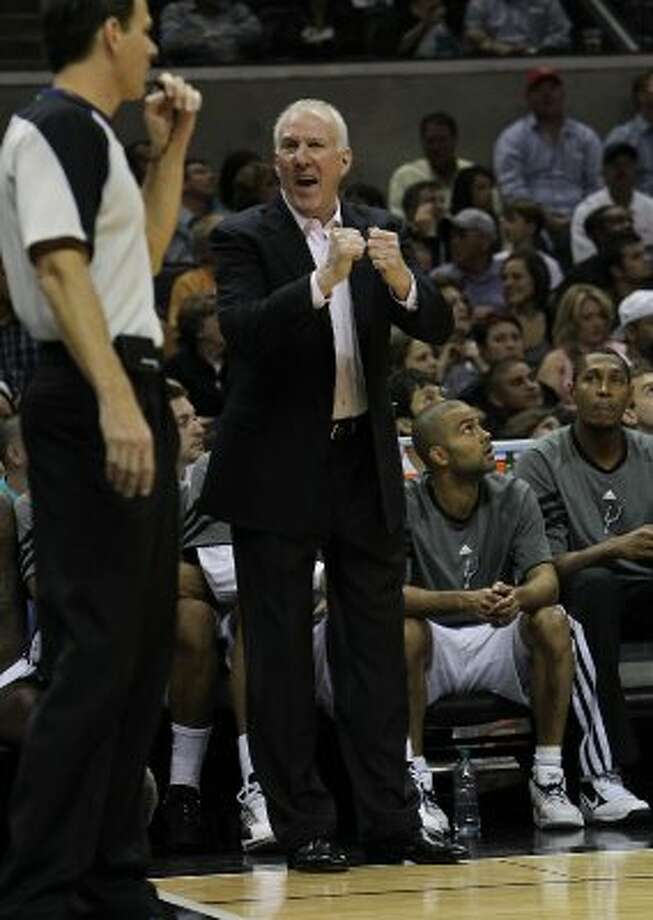Spurs coach Gregg Popovich debates a call with a game official during the first half against the Los Angeles Lakers at the AT&T Center on Friday, Apr. 20, 2012. Kin Man Hui/Express-News. (San Antonio Express-News)