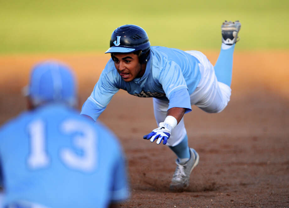 Johnson's Jo Jo Collazo slides into third with a triple during a 26-5A varsity baseball game between the Johnson Jaguars and the Reagan Rattlers on April 20, 2012 a the NEISD Blossom Baseball Field in San Antonio Texas.