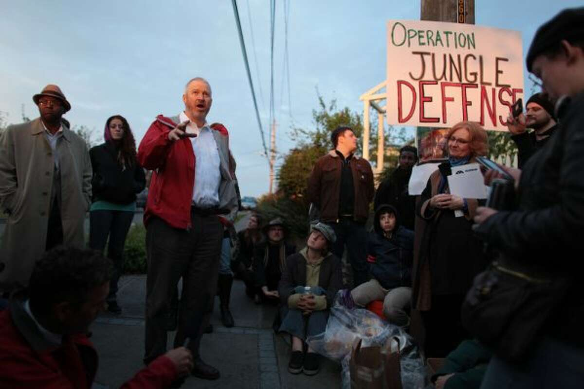 """Seattle Mayor Mike McGinn listens to homeless advocates that came to his Greenwood home asking that he allow homeless campers to remain in """"The Jungle,"""" a greenbelt on the west side of Beacon Hill. (JOSHUA TRUJILLO / SEATTLEPI.COM)"""