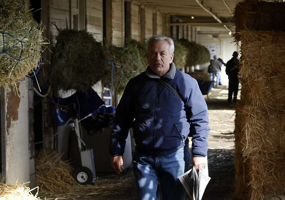 Trainer Jerry Hollendorfer walks through his barn after watching the morning training session at Golden Gate Fields in Berkeley, Calif., on Friday, April 24, 2009. Photo: Paul Chinn, The Chronicle