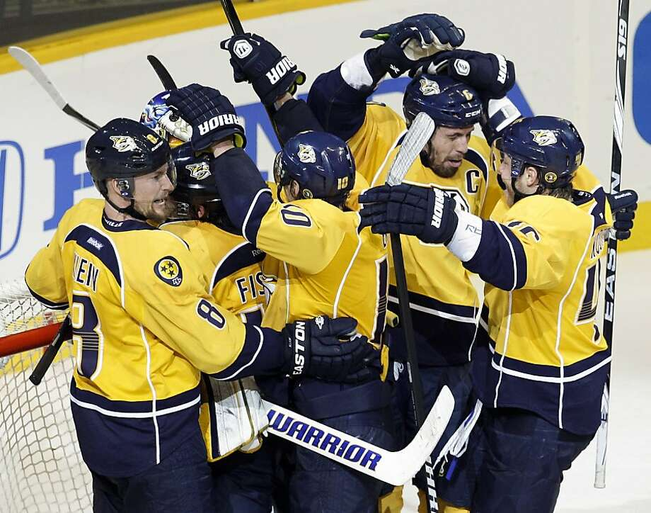 The Nashville Predators celebrate their 2-1 win over the Detroit Red Wings in Game 5 of a first-round NHL Stanley Cup hockey playoff series on Friday, April 20, 2012, in Nashville, Tenn. The Predators won the series 4-1. (AP Photo/Mark Humphrey) Photo: Mark Humphrey, Associated Press
