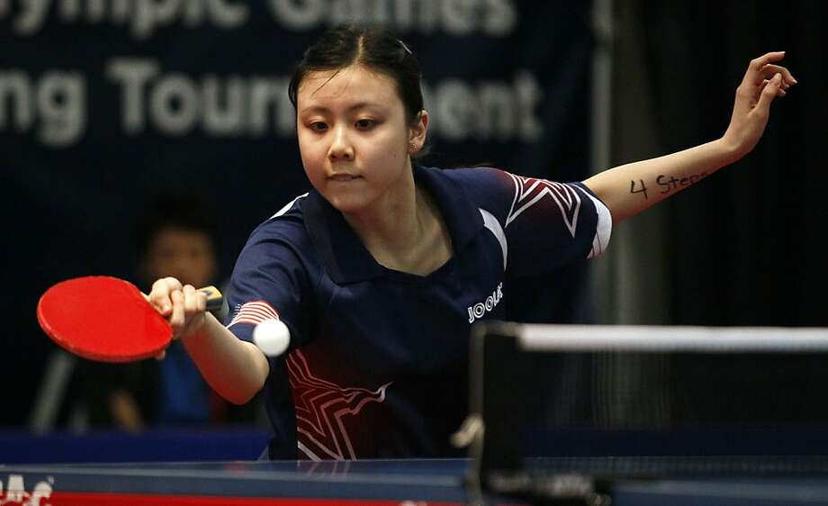 United States' Ariel Hsing hits the ball against Canada's Chris Xu during the final women's singles match of the North America 2012 Olympic Games table tennis qualifying tournament in Cary, N.C., Friday, April 20, 2012. Hsing won the match. (AP Photo/Gerry Broome) Photo: Gerry Broome, Associated Press