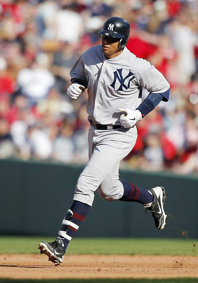 New York Yankees' Alex Rodriguez rounds the bases on a solo home run in the fifth inning of a baseball game against the Boston Red Sox in Boston, Friday, April 20, 2012. (AP Photo/Michael Dwyer) Photo: Michael Dwyer, Associated Press