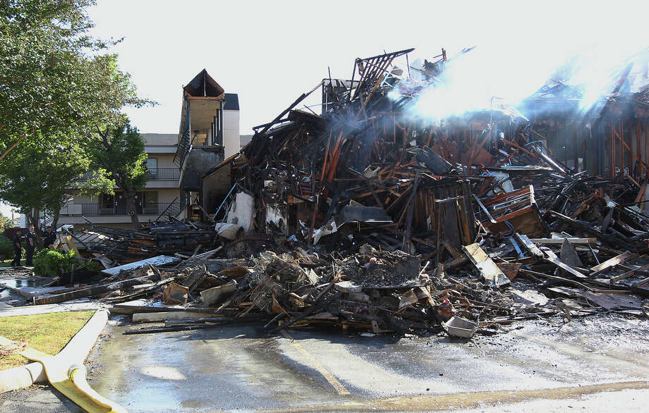 Charred remnants of the Studio 6 hotel are mostly left standing on Saturday, Apr. 21, 2012. The fire had 46 firefighting units called to the scene on Friday afternoon to battle the blaze. None of the occupants or the more than 100 firefighters were reported injured in the massive fire. Photo: Kin Man Hui, Kin Man Hui/Express-News / ©2012 San Antonio Express-News
