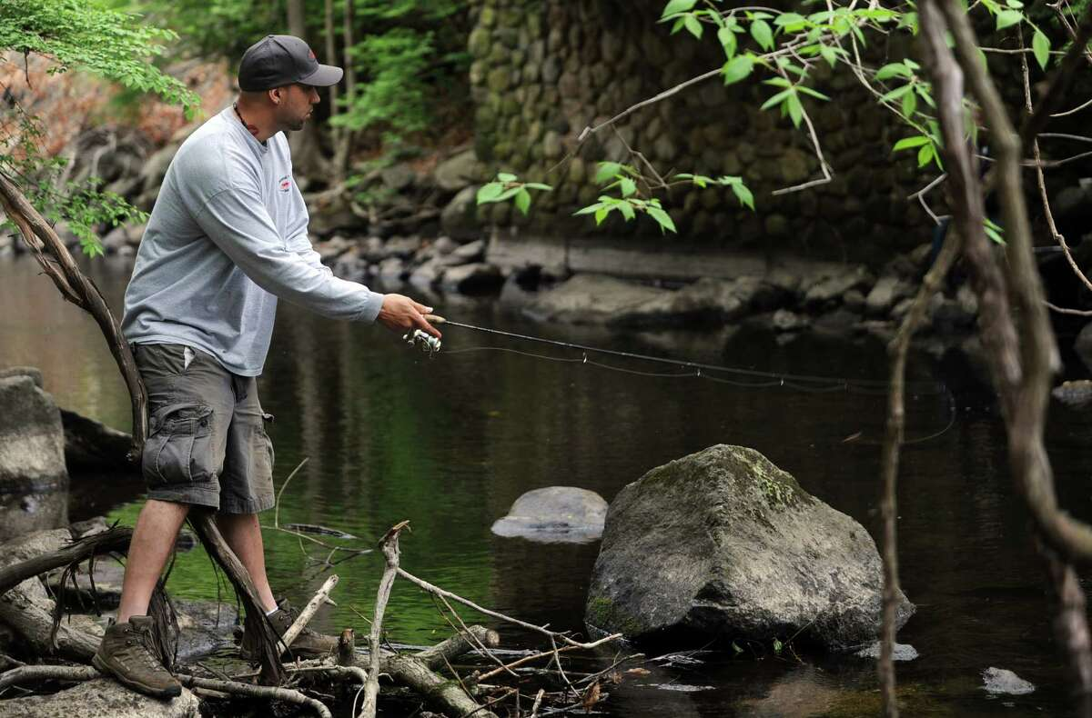 Eric Stahl fishes in the Mianus River at Mianus River Park in Stamford on Saturday, April 21, 2012.