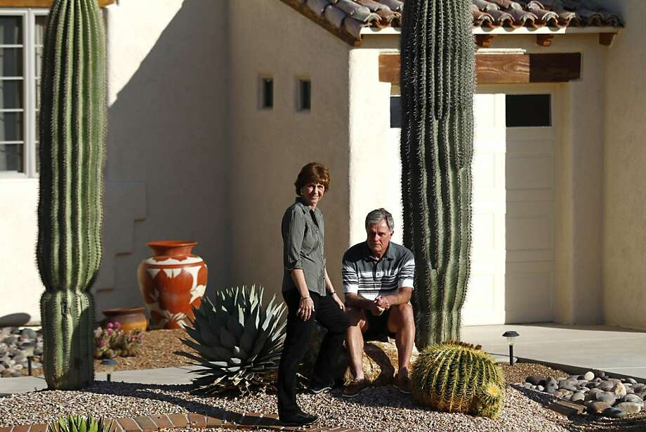 Paula McCloskey and her husband Barney McCloskey pose for a portrait outside of their home in Green Valley, Arizona April, 14, 2012. The McCloskey who were trying to sell their 2,500 square foot home with 2 bedrooms and 2.5 bathrooms for $379,000 were unsuccessful after having their home on the real estate market for 6 months. Wanting to be closer to their twin grandsons in San Jose, California, the McCloskey's will try and swap their home for another after posting an add on Craigslist.  Joshua Lott for the San Francisco Chronicle Photo: Joshua Lott,  SAN FRANCISCO CHRONICLE