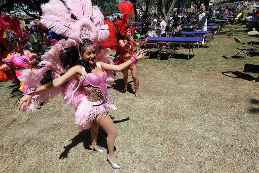 Dancers from Samba Vida Drum & Dance delight the crowds with their entrance and performance at the 2012 Fiesta Oyster Bake at St. Mary's University on Saturday, Apr. 21, 2012. Proceeds from the event go toward scholarships and university programs. Photo: Kin Man Hui, Kin Man Hui/Express-News / ©2012 San Antonio Express-News