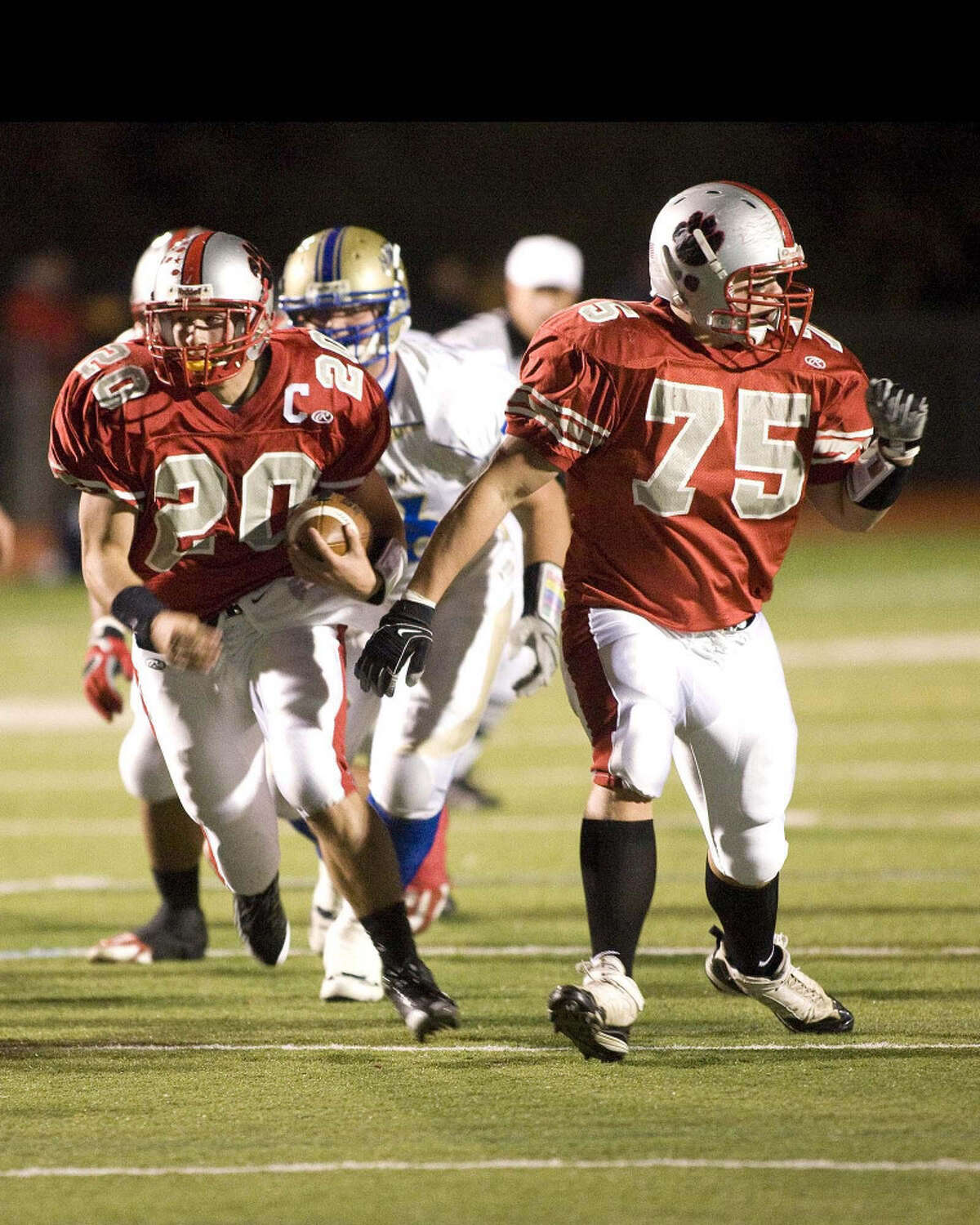 Pomperaug's Ben Crick (left) runs for yardage during a regular-season game against Newtown. Crick, who has run for over 1,500 yards, leads his team against Masuk in the SWC Championship game tonight at Arum Field.