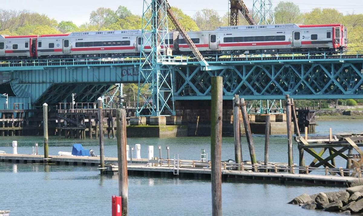 A train heads west on the Cos Cob railroad bridge, Thursday, April 19, 2012. The Cos Cob moveable railroad bridge is more than a century old.