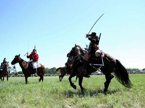 Reenactors dressed as Texian and Mexican soldiers clash during a scene on horseback on he battlefield during the reenactment commemorating the 176th anniversary of the battle of San Jacinto at the San Jacinto Battleground, Saturday, April 21, 2012, in Houston. Photo: Karen Warren, Houston Chronicle / © 2012  Houston Chronicle