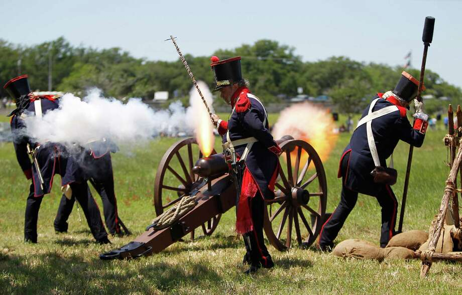 Reenactors dressed in Mexican army uniforms fire a cannon before the start of the San Jacinto battleground reenactment commemorating the 176th anniversary of the battle of San Jacinto at the San Jacinto battleground, Saturday, April 21, 2012, in Houston. Photo: Karen Warren, Houston Chronicle / © 2012  Houston Chronicle