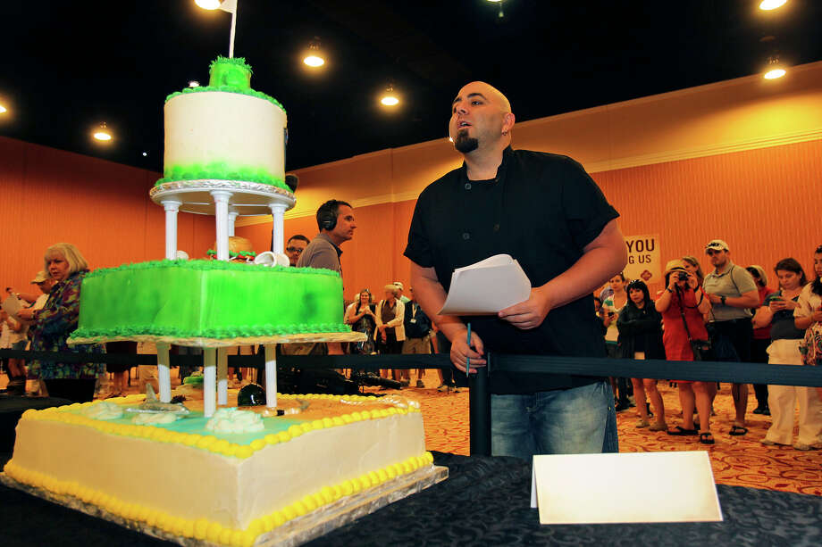 Duff Goldman judges one of six cakes at the VTO celebrity cake off during the third  round of the 2012 Valero Texas Open on  April 19, 2012. Photo: TOM REEL, San Antonio Express-News / San Antonio Express-News