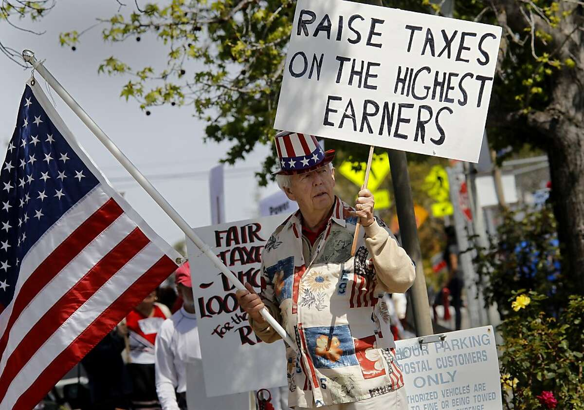 Harry Fish from Moraga joined the demonstration in front of the Post Office in Walnut Creek. Occupy activists demonstrated in Walnut Creek, Calif. to call attention and honor those Americans who pay their fair share of taxes. These more peaceful Occupiers prefer to call themselves 99 Percenters to set themselves apart from the violent activists.