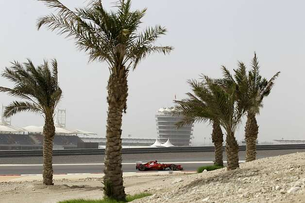Ferrari driver Fernando Alonso of Spain steers his car during the qualifying session ahead of the Bahrain Formula One Grand Prix at the Bahrain International Circuit in Sakhir, Bahrain, Saturday, April 21, 2012. The Bahrain Formula One Grand Prix will take place here on Sunday. Photo: Hassan Ammar, Associated Press