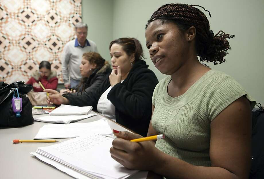 In this photo taken March 16, 2012, immigrant Martha Johnson from Liberia, right, attends and American history and civic class in Chelsea, Mass., in preparation for a naturalization test.Hundreds of volunteers are helping qualified immigrants become U.S. citizens in time to register to vote in the November presidential elections. Photo: Rodrique Ngowi, Associated Press
