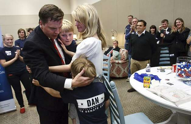 Former state Sen. Dan Liljenquist hugs his wife Brooke and sons Nate, 7, and Ben, 4, after learning that he and U.S. Sen. Orrin Hatch will face a primary election, Saturday, April 21, 2012 in Sandy, Utah. Utah Republicans denied U.S. Sen. Orrin Hatch a clear path to a seventh and final term Saturday, forcing the 78-year-old lawmaker into a June primary with 37-year-old former state Sen. Dan Liljenquist. Hatch fell short of the nomination by fewer than three dozen votes from the nearly 4,000 delegates at the party convention. (AP Photo/The Salt Lake Tribune, Leah Hogsten) Photo: Leah Hogsten, Associated Press