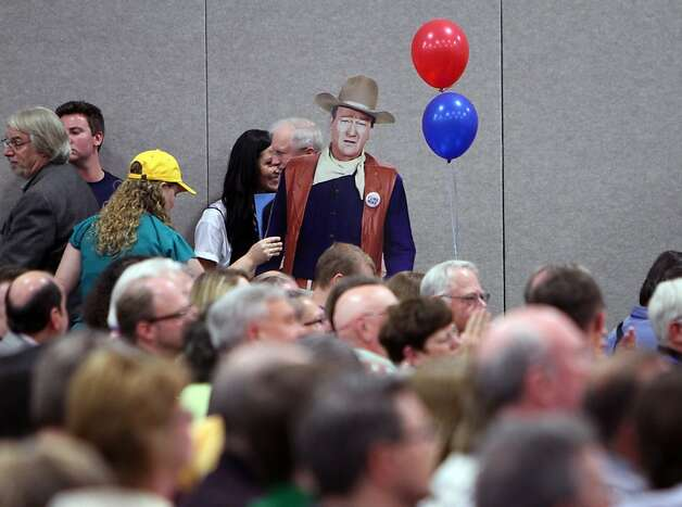 John Wayne makes an appearance as the Utah Democrats hold their state convention, Saturday, April 21, 2012  at the Calvin L. Rampton Salt Palace Convention Center in Salt Lake City. (AP Photo/The Salt Lake Tribune, Francisco Kjolseth) Photo: Francisco Kjolseth, Associated Press