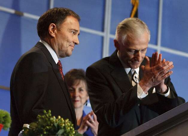 Utah Governor Gary Herbert, left, acknowledges supporters at the Democratic state convention, Saturday, April 21, 2012  at the Calvin L. Rampton Salt Palace Convention Center in Salt Lake City. (AP Photo/The Salt Lake Tribune, Francisco Kjolseth) Photo: Francisco Kjolseth, Associated Press